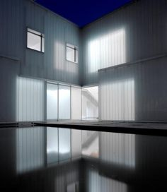 """i am going to include the """"sand-blasted translucent structural glass planks """" material for my design as i feel it will aid to the idea of my building being a beacon of light. the interior light will be illuminated from the outside by this material  The New Residence at The Swiss Embassy by Steven Holl Architects"""