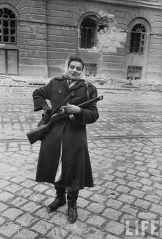 Female Hungarian freedom fighter smiles at the photographer during fighting in Budapest against invading Soviet forces, Hungarian Uprising, Nov She is armed with Soviet SMG. Bridal Boudoir Photos, Brave Women, War Photography, Freedom Fighters, Modern History, Women In History, World War Two, Historical Photos, Budapest