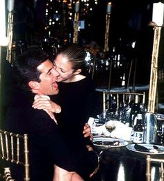 The couple have a good laugh at the Hilton in New York City, June 1996. *By John Barrett/Globe Photos, Inc.*
