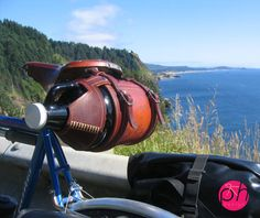 Want to carry some craft beer along for the ride? This gorgeous leather beer growler carrier will do the trick.