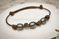 Freshwater Pearl and Leather Bracelet - Brown leather with Peacock Pearls, Surfer Chic - 'Yolo' by LeatherPearlJewelry on Etsy https://www.etsy.com/listing/90962135/freshwater-pearl-and-leather-bracelet