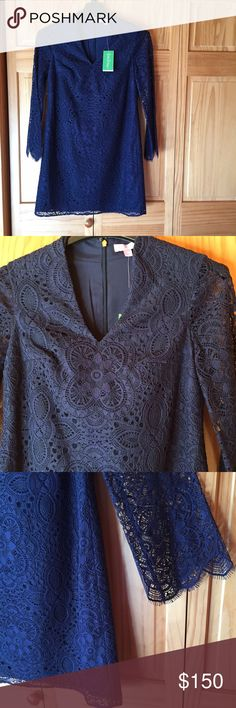 NWT Lilly Pulitzer Dress Brand new! Such a beautiful dress with scalloped lace sleeves. Entire body of dress lined. Second picture shows true navy coloring.  Back zipper still even has plastic protection. Lilly Pulitzer Dresses Long Sleeve