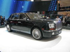 The Chinese put some interesting touches on the car, with a rear seat that is much higher than the front and is centered for a true position of power. The 17 1/2 foot monster will be the first offering from YingLun or EngLon (England/London) as brand of Geely.
