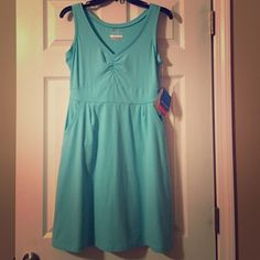 Columbia dress Mint green omni-wick dress. Has pockets. V neck. New with tags. No trades. Columbia Dresses