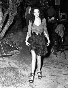 Jane on the set of THE OUTLAW (1943).   This must have been right after she filmed the scene where Rio knocked Billy The Kid in a small pond and tried to drown him.  Photo is dated circa, 1941