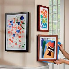 "Children's Artwork Frames: $34.99 - $44.99    This unique artwork frame displays one ""masterpiece"" at a time, but stores up to 50 more behind it for later display. Lift the latch on this artwork frame to open the glass front door, and place the newest drawing into the pocket. Close the door, and the latest creation is displayed for all to see, with the other ones stored behind it.     LOVE THIS!!!!!"