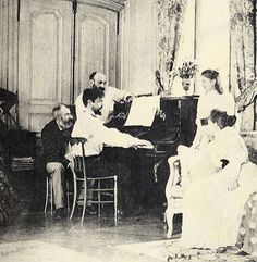 Anonymous: Claude Debussy at the piano, in the home of Ernest Chausson, Luzancy, August 1893  Photograph