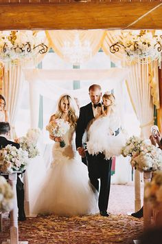 "We are loving this shot of #EnzoaniRealBride Whitney, groom Brian, and daughter Brielle  walking down the isle after they said ""I do!""."