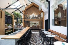 Photo 2 of 7 in Boutique Coffee Roaster Coperaco's First Cafe Holds a Modern Tree House - Dwell