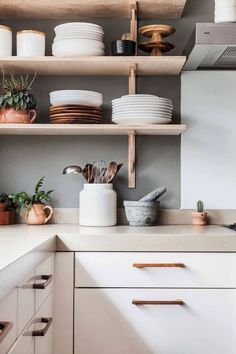 Modern Kitchen Decor : Those copper accents are giving us life. Modern Kitchen Design Accents Copper decor giving Kitchen life Modern Kitchen Ikea, White Kitchen Cabinets, Kitchen Cabinet Design, Interior Design Kitchen, New Kitchen, Kitchen Dining, Wood Cabinets, Kitchen Shelves, Simple Interior