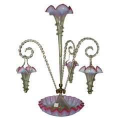 English Epergne with Hanging Baskets  Stourbridge England  19thC  A wonderful Stourbridge England Victorian Tri colored Epergne with one large central tulip & 3 canes and 3 hanging baskets all in the same color scheme of cranberry, opalescent blue and vaseline which is most attractive.