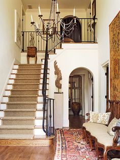 Entry with stairs to left going up to observation; passage under to master suite.