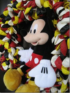 Mickey Mouse Birthday Wreath using a straw wreath and balloons.