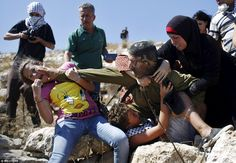 Agosto2015 The soldier fights back as the girl tries to prevent him from detaining the boy during a protest  in the West Bank village of Nabi Saleh