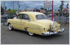 I almost bought a 52' Deluxe, except it was pearl white with red crush velvet interior. I really wish I would have bought it now! 1952 Chevy  Deluxe with continental kit