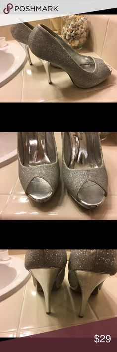 """De Blossom Collection Silver Glitter Platforms These 5"""" high, silver glitter, peep toe platforms are definitely a showstopper!  The silver is a neutral so you can wear with lots of different colors.  Perfect for prom or Formal! De Blossom Collection Shoes Platforms"""
