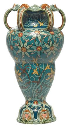 Dramatic Mettlach vase, large unusual shape with six looping handles at top above a finely incised and painted floral design, artist initial H