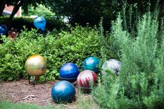 Collect old bowling balls at yard sales - makes for great yard art!