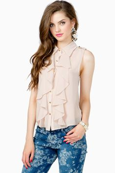 A gorgeous sleeveless chiffon shirt with a double ruffle feature along the front. Button front closure. Sheer chiffon body.