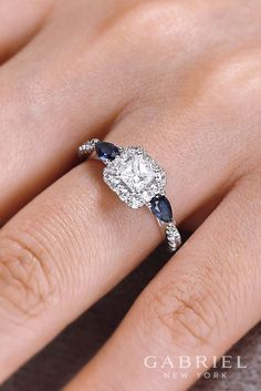 14k White Gold Princess Cut Halo engagement ring. Wear sapphire - the color of the Royals by rocking this pear cut sapphires in this beautiful diamond engagement ring.