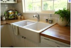 White cabinets, butcher block counters and white subway tile ... These are a few of my favorite things.