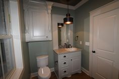 Guest bath with custom vanity, pendant lighting, and abundant storage.