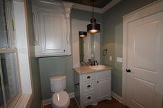 Guest bath with custom vanity, pendant lighting, and abundant storage.