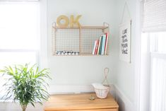 Project Nursery - Nursery with Rose Gold Wall Shelf and Greenery in the Nursery - Project Nursery