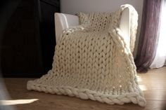 Natural white chunky knit blanket is so cosy, soft and warm - 100% MERINO WOOL. Makes a perfect present for someone special. This Chunky knit blanket is suitable for the living room and/or bedroom. It could be used while having a rest, watching TV or reading a good book or simply as a décor which will be noticed by all your guests.  So if you are looking for the best ways to make guests feel welcome and comfortable during this winter season or you are looking for the most memorable prese...