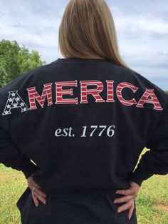 This God Bless America Spirit Jersey is made on a Boxercraft Pom Pom Jersey with double tonal athletic stripes on sleeves. Roomy, unisex fit Available in Charcoal cotton/polyester) Available in White cotton) Available in Light Gray cotton) All American Girl, American Pride, American Flag, Summer Outfits, Girl Outfits, Cute Outfits, Holiday Outfits, School Outfits, Spirit Jersey