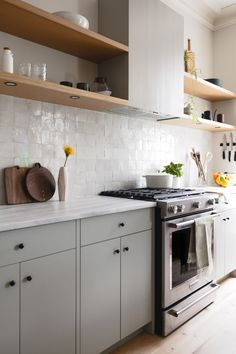 Kitchen of the Week: A Brooklyn Kitchen Designed Around the Keywords Social and Minimal but Warm Kitchen of the Week: A Brooklyn Kitchen Designed Around the Keywords Social and Minimal but Warm - Remodelista Warm Kitchen, Kitchen Hoods, New Kitchen, Kitchen Dining, Kitchen Cabinets, Wall Tiles For Kitchen, Small Condo Kitchen, Awesome Kitchen, Kitchen Countertops