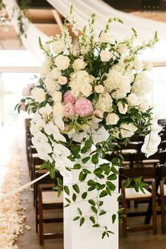 Lush ceremony decor idea - floral + greenery ceremony decor as aisle markers - white + blush roses, peonies, hydrangeas, and orchids {Jenny DeMarco Photography}
