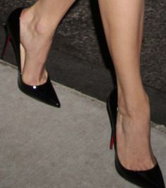 "Emmy's classic patent black ""So Kate"" pumps from Christian Louboutin"