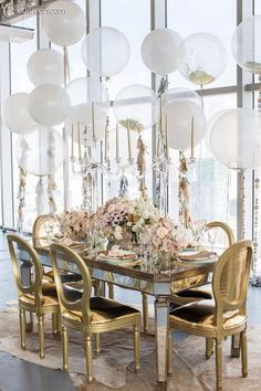 Gold chair magic. Love this with the clear balloons floating above the table.
