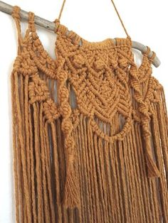 This macrame wall hanging is hand-made by Hanifah Tohir. This knotted mustard piece is perfect to hang for a boho feel in your bedroom, living room or your bathroom.  Measurement Length 56cm approx Height 75cm approx
