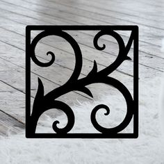 This decorative Wrought Iron Wall Art piece, Style 213, features a Geometric square silhouette that will add beauty and character to any wall or surface. It is coated in one of the most long-lasting finishes available - a flat black baked-on powder coated finish that will last for many years.