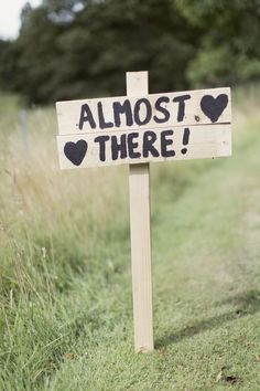 Wooden 'Almost there' wedding direction sign - Image by Craig & Eva Sanders Photography - Ian Stuart Frederique and Rachel simpson mimosa shoes for a rustic wedding in Scotland with light mocha bridesmaids dresses, a neutral colour scheme and DIY details