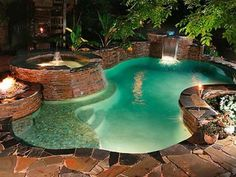 I'm a huge fan of the stone look, hot tubs, & waterfalls. Put this in my backyard now! As long as someone else cleans and cares for it! LOL