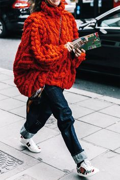 For a bold statement, sneakers look cool with contrasting socks and rolled-up jeans.