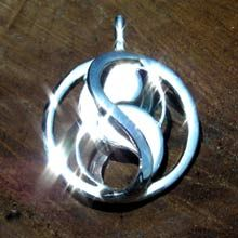 'Entangled' pendant silver  Designed by Judy Hilton and Pat Crelly as a sacred geometry symbol of unity