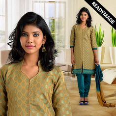 This mustard coloured benarasi kurti is open till the bottom hemline with piping at its centre. The hemline has an embroidered lace with taping on its ¾ sleeves. The bottom in blended fabric and a 2 toned dupatta completes the suit.  Visit www.vastraanjali.com for more details and online shopping
