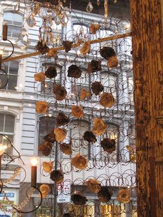 This curtain was spotted in NYC. Note that it's made of old mattress springs. Amazing Idea