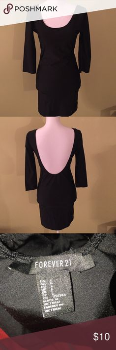 H&M Black bodycon dress Mini Black long sleeve bodycon dress with the back out. Forever 21 Dresses Long Sleeve