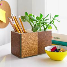 Cork Office Caddy - Join two square pencil holders with permanent glue; let dry. Attach cork floor samples (available at local home centers) to the sides and ends of the dual caddy with permanent glue. Once dry, fill one side with pencils and create a planter on the other side. Line the bottom of the planter with a 1- to 2-inch layer of gravel or sand. Plant a succulent (or another plant that doesn't need a lot of water and maintenance) to green up your desk.