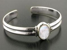 Adjustable Sterling Silver Cuff Bracelet with a 5.5ct Genuine Rainbow Moonstone Center Gem Silver Insanity http://www.amazon.com/dp/B000JME5QY/ref=cm_sw_r_pi_dp_0IuYtb1SJAP09J4H