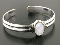 Adjustable Sterling Silver Cuff Bracelet with a 5.5ct Genuine Rainbow Moonstone Center Gem Silver Insanity http://www.amazon.com/dp/B000JME5QY/ref=cm_sw_r_pi_dp_0IuYtb1SJAP09J4H