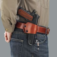 The renowned Yaqui Slide was ushered into the modern era of holster design in 1992 when Galco achieved yet another industry first: adding a set of independent tension screw adjustments, allowing for a custom fit to the firearm and micro-adjustment of 1911 Holster, Pistol Holster, Leather Holster, Leather Tooling, 1911 Pistol, Saddle Leather, Revolver, Beretta 92, Weapon Storage