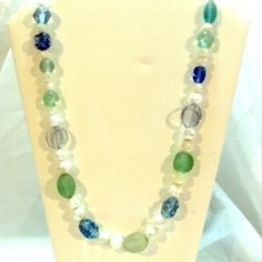 http://www.bitzofglitz.co  Shades of Blues, Greens,and White Glass Bead Long Necklace  $20.00