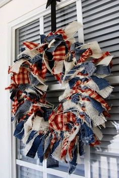 Rag Wreath: Upcycle an old pair of jeans or any piece of denim to make this Americana-inspired piece. Click through to find more quick, DIY 4th of July wreaths to add to your summer home decor.