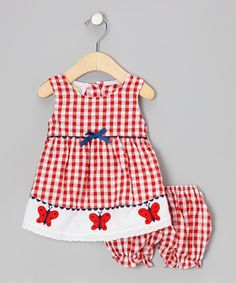 Beautiful butterflies will love the garden-fresh color and appliqués on this flourishing frock. Buttons in back and an elastic waistband on the matching bloomers make the convenient combo simple to slip on too.
